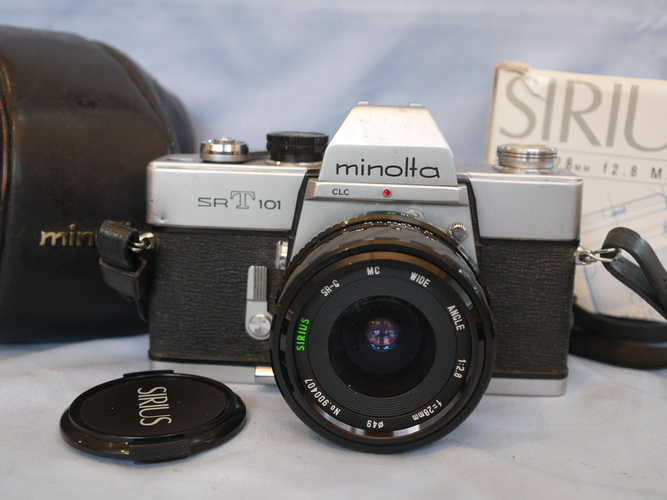how to close lens on minolta srt 101