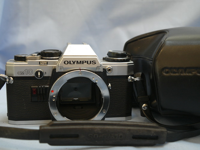 how to open olympus om10